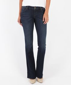 Made from a deep indigo wash, this pair of jeans are cut in a bootcut shape that is fitted through the waist and thighs and relaxed through the legs with a slight flare for the baby bootcut look.