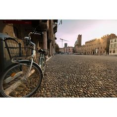 Sunset over town square in Mantua, Italy. Love it! - Instagram by travelwithbender