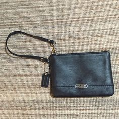 Coach leather wristlet clutch Perfect condition. One little pocket inside, as shown.  Prices are negotiable; make me an offer!  Coach Bags Clutches & Wristlets