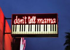 Don't Tell Mama neon sign (bar) on East Fremont Street in Downtown Las Vegas