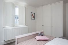 Solid Panels Shutters by Plantation Shutters Ltd Wooden Shutters Indoor, Wooden Windows, Shutter Images, Bedroom Windows, Wainscoting, Interior Styling, Toddler Bed, Contemporary, House Styles