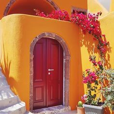 Colours of SantoriniYeah not everything is blue and white in Santorini. There are some beautiful corners like this. You just have to look for them