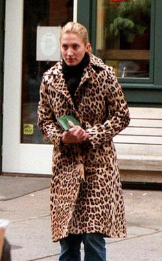 Carolyn Bessette-Kennedy; classic red lipstick and a tailored leopard coat. She remains a timeless style icon.