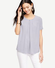 "Detailed with asymmetric front pleats, our matte jersey tee is perfect to wear - any day of the week. Jewel neck. Short sleeves. Hidden back zipper with hook-and-eye closure. 26"" front length; 25 1/4"" back length."