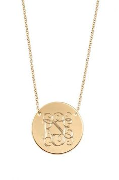 More than a charm necklace, this gold monogrammed necklace works great as a nameplate. Try the Gold Signature Engravable Disc Necklace from Stella & Dot.