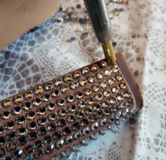 She shows you how to bling out your shoes. Make your plain heels sparkle!