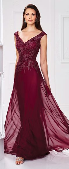 Two-tone chiffon and lace A-line gown with slight cap sleeves, front and back V-necklines, hand-beaded lace bodice, asymmetrically dropped waistline, sweep train. Matching shawl included.