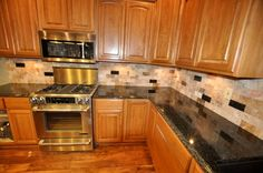 Medium Maple Cabinets with light Granite countertops and Light