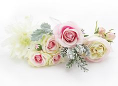 Pink/cream spray roses, santolina, dusty miller, dahlia, paris roses and a cool pink fresh touch rose - a gorgeous combo for bride or BMs alike. Design your own unique wedding flowers at http://www.loveflowers.com.au