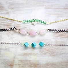 Delicate bracelets made with beads and chain.