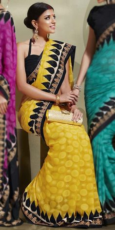 yellow sari with black halter neck blouse. Very nice