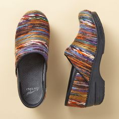 "YARN CLOGS -- Welcome cooler weather with the bright color and texture of Dansko®'s yarn-wrapped clogs. Classic Scandinavian shape and all-day comfort. Imported. Euro whole sizes 36 to 41. 36 (US 6.75), 37 (US 7.5), 38 (US 8.25), 39 (US 9), 40 (US 9.75), 41 (US 10.5). 2"" heel."