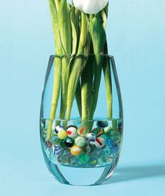 Add marbles to the bottom of a vase to keep your florals in the drink and make arranging, well, child's play.