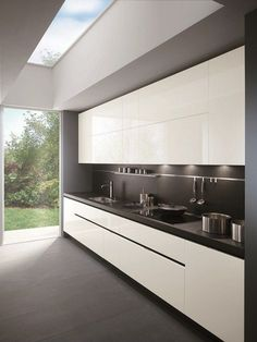 dark floor, dark benchtop, dark splashback, white cupboards