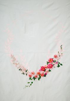 A modern art backdrop complete with pink paint and fresh flowers: http://www.stylemepretty.com/little-black-book-blog/2014/12/05/modern-art-inspired-styled-wedding-shoot/ | Photography: Bamber - http://www.bamberphotography.com/