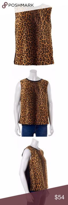 """MILLY Faux Fur Leopard Top Leather Trim Sleeveless A fantastic layering piece over or under, leopard-print, faux fur front panel adds a wild touch to a knit Milly shell. Smooth leather lambskin trim traces the scoop neckline, and a single-button keyhole closes the back. Sleeveless. Hidden side zip. Lined. Size: 10 Medium Retail for $215.00 Trim: Lambskin Fabric: Faux fur / knit. Shell: 49% cotton/34% viscose/17% modal. Chest: 40"""" Bottom: 42"""" Length: 24"""" Edgy, Avant Garde, Fashion…"""