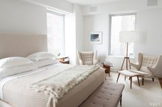 Ferebee Taube's Midtown NY apartment bedroom...love the neutral palette, and adore the Hans Wegner Papa Bear chairs...