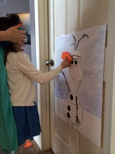 Disney Frozen birthday party - Pin the nose on Olaf