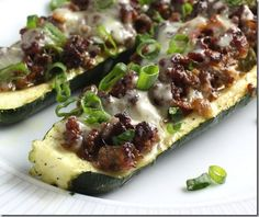 Zucchini topped with ground beef (or turkey), cheese and green onions.