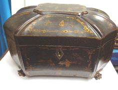 Chinese Export Lacquered Tea Caddy. Carved feet,  Circa 1800 - 1820