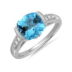 Tresara™ Blue Topaz and Diamond Ring. 3.20 Carat T.W. blue topaz ring features 0.08 Carat T.W. channel set diamond accents. The high-polished mounting is crafted of genuine sterling silver.