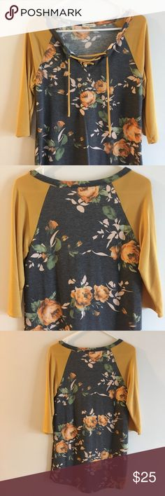 12 PM by Mon Ami Floral 3/4 Raglan This beautiful top is in excellent condition and has never been worn. It has a lace up detail as a lovely floral pattern. It is mustard yellow and gray. 12 Pm By Mon Ami Tops