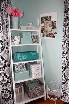 """I found this on at Hobby Lobby for 1/2 price, painted it white (3 coats). Top shelf has a blue bucket from Hobby Lobby Easter section, a 4 compartment wooden organizer """"Bloom"""" from Michaels, and a tea cup from my tea cup collection. The 2nd shelf has my demask pig (Target), Aqua lacquered boxes from TJ Max and a demask frame from Target.  3rd shelf."""