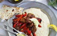Warm chickpea and onion purée with sizzling peppers and lamb