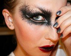 black feather eyeshadow, red lip