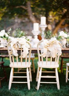 Head table with Mr + Mrs dining chairs from Found Vintage Rentals