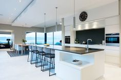 A modern and stylish white kitchen showcasing strong clean lines and views. Featuring Dark Horse Leather Stretchback kitchen chairs. #style #modern #kitchen #architecture #interiordesign #design #luxury #white #oceanview Andalusian Horse, Friesian Horse, Arabian Horses, Black Horses, Dark Horse, South African Design, Blue Roan, Kitchen Chairs, Clean Lines