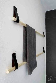 Up-cycled Leather Belt- cut looped & tacked to wall. You can get these wooden poles at any home improvement store in any size. A towel rack is shown here, but this project can be tweeked for several uses..for example, scarves. *note: you can use any material or style belt strong enough for what u want to hold. think of all the chic belts there are with designs, colors, animal print, floral, embroidered even. you can rlly make it look cool & match your decor.