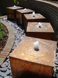rusty water feature   http://www.penchantdesigns.co.uk