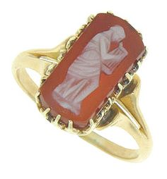 This lovely full figured antique cameo is set in a 14K gold band. The figure is dressed in a flowing belted Grecian gown playing a musical instrument. The cameo is a rich color and delicately carved. Circa: 1880. The ring measures 14.75 mm in width. Size 7 1/4. We can resize.