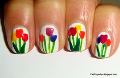 Colorful tulips on white nails.