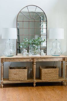 Welcome your guest in style with a pretty entry Everett foyer table styling with pretty lamps arch mirror and baskets thehomeicreate entrywaydecor entrywaydecorideas entryway foyerdecorating foyerdesign lampmakeover Foyer Design, Living Room Designs, Living Room Decor, Entry Tables, Sofa Tables, Hallway Tables, Table Lamps, Farmhouse Side Table, Foyer Decorating
