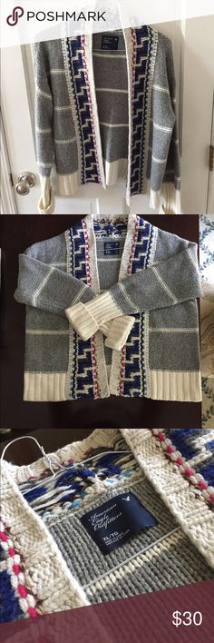 American Eagle Woven Print Wool Sweater American Eagle Woven Print Wool Sweater. Gray and cream stripe with blue and pink accents. Heavy duty sweater for chilly weather! American Eagle Outfitters Sweaters Cardigans