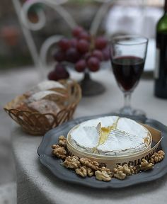 Looks really yummy. Camembert cheese, melt in oven, served with walnuts, fresh baguette  wine.