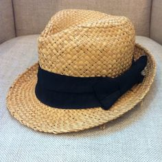 Fedora Hat Fedora hat in good condition. Straw material I believe, with a black bow. Cute to dress up a bathing suit or outfit. Accessories Hats
