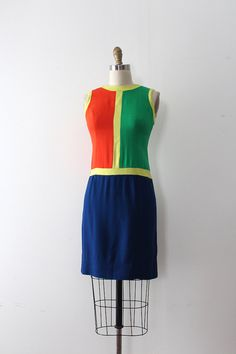RARE 1960s color block dress inspired by Yves Saint Laurents Mondrian dress. This dress features a simple silhouette with four colours. (far colour is red not orange)