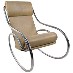 For Sale on - This vintage metal and vinyl rocking chair features a stylish chrome frame with unique circular rockers. Vintage vinyl covering is sculpted for ergonomic Mid Century Modern Armchair, Mid Century Chair, Metal Rocking Chair, Rocking Chairs, Polywood Adirondack Chairs, Small Accent Chairs, Vintage Chairs, Vintage Metal, Modern Chairs
