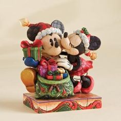 Mickey And Minnie - A Christmas Kiss Jim Shore Disney Traditions Collection - Available at Ann's Gift Shop. Hades Disney, Walt Disney, Disney Love, Disney Mickey, Disney Stuff, Jim Shore Christmas, Christmas Kiss, Mickey Christmas, Christmas Themes