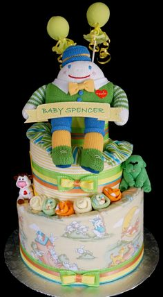 Nursery Rhyme Diaper Cake Topped with Humpty Dumpty www.facebook.com/DiaperCakesbyDiana