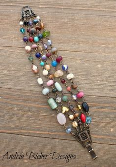 Mixed colors. Wire wrapped multi strand Czech glass and stone, with bronze metal bracelet. #wirejewelry
