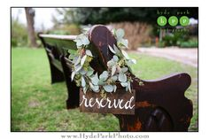 Reserved sign adorned with greenery hanging on a vintage church pew at an outdoor @barrmansion wedding. Photo by @hydeparkphoto. See more at http://www.hydeparkphoto.com/barr-mansion-brunch-wedding/ ||| Austin weddings, Austin wedding photographers, Austin wedding venues, Austin wedding venues outdoors, Austin wedding chapels, Barr Mansion, organic wedding venue, brunch wedding, Hyde Park Photography, wedding blog, wedding ideas, wedding reserved sign, wedding details, wedding seat ideas