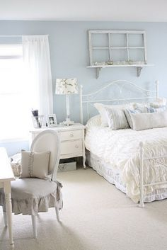 Love the wall color and the window frame accent on the shelf above the bed.