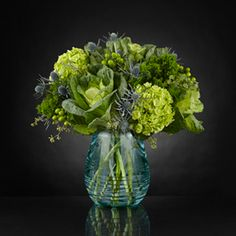send The FTD® Ocean\'s Allure™ Luxury Bouquet  An arrangement that plays on shades of green and textures that draw you in www.americasfloristnyc.com