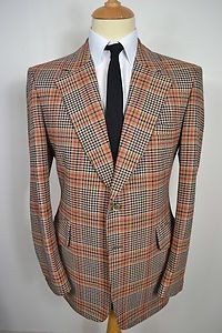 A VINTAGE 1970's SYDMOR WOOL BLAZER.    Item Description:        A MEN'S UK MEDIUM 40 REGULAR FITTING (detailed measurements given below). Brown with orange check colour. Two buttoned (all original). Flapped pockets at the waist and a slit pocket at the left breast. Single button cuffs. Made from Wool. Brown lining with two inside pockets. Genuine British vintage made in England by Sydmor. Excellent condition. Dry cleaned and steam pressed before being listed.