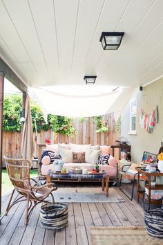 pallet daybed Also love the plank deck and shade - want to put something like this off the master bedroom