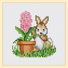 Free rabbit with hyacinth cross stitch pattern by Ellen Maurer-Stroh.